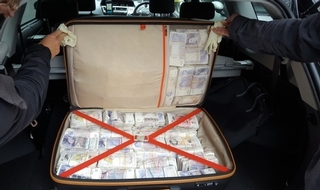 A travel bag recovered by officers contained half a million pounds in cash