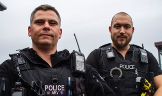 Two firearms officers fought to save helicopter crash victim
