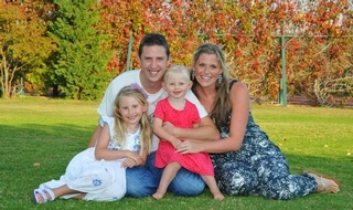 PC Dave Phillips, pictured with his wife Jen and their two daughters, was killed on Monday morning