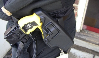 Drunk father uses own baby as shield during police taser incident