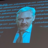 Assange remains in embassy after arrest threat
