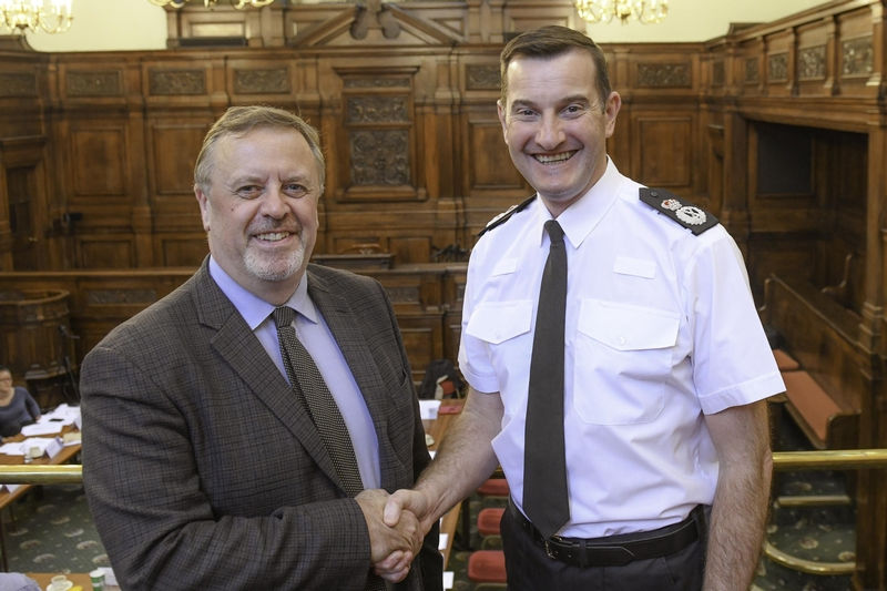 Official handover: CC John Robins, right, with West Yorkshire PCC Mark Burns-Williamson