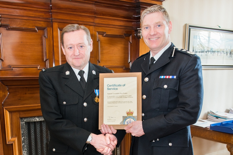 Good Evans: Temporary Deputy Chief Constable Russ Foster, right, says farewell to SC Roy Evans