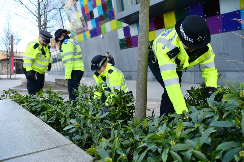 Weapons sweep: Met officers Officers search for knives outside the Glass Mill Centre in Lewisham, south London, as part of Operation Sceptre