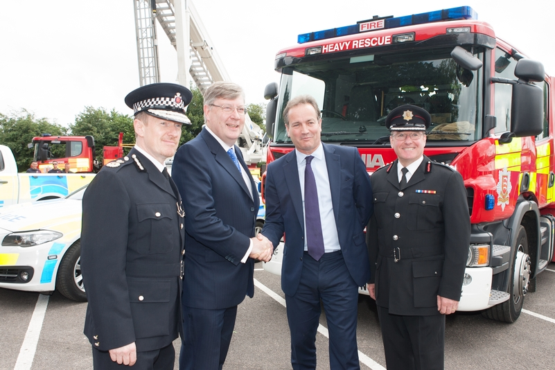 Roger Hirst (second from left) shaking hands with Policing Minister Nick Hurd earlier this year when he became police, fire and crime commissioner